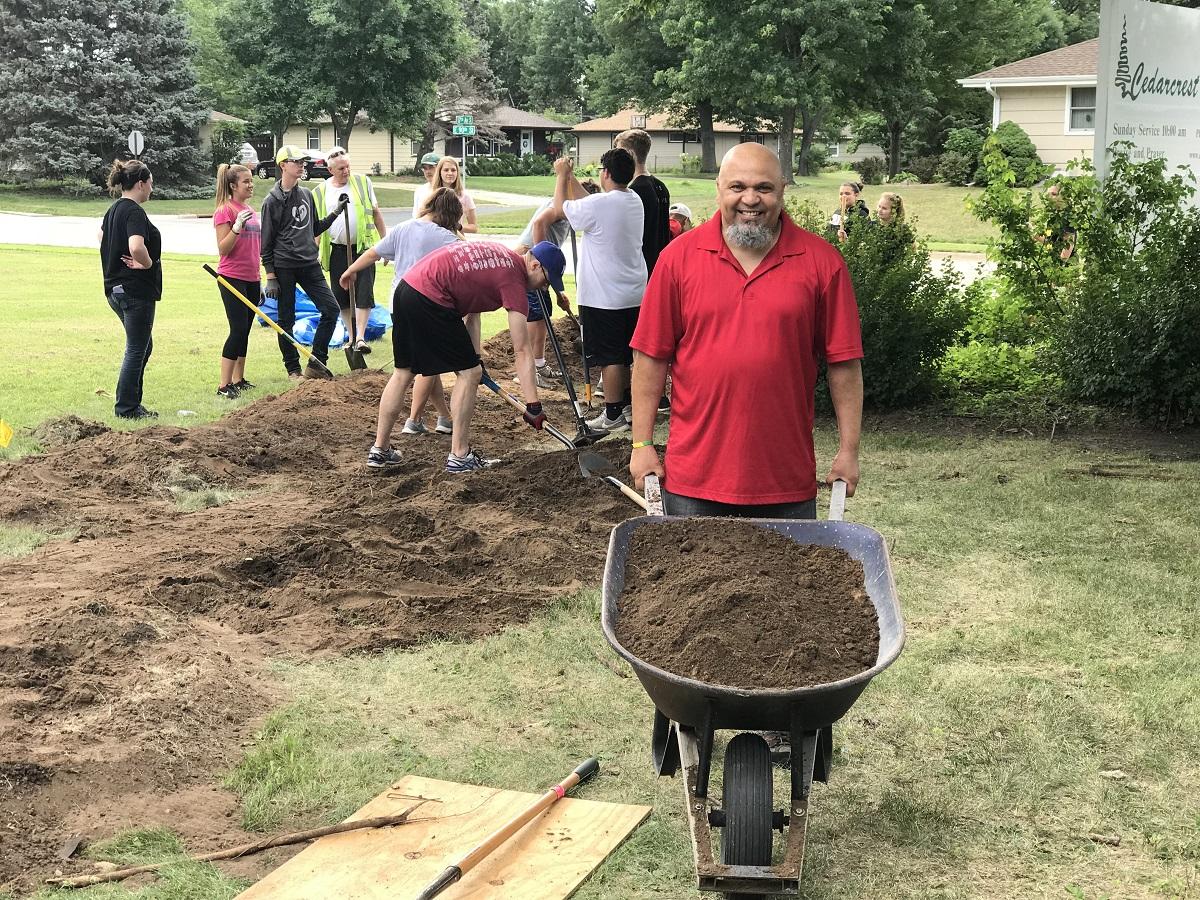 volunteers doing yard work image